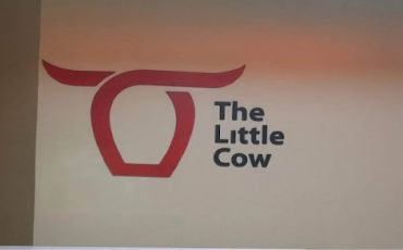 The Little Cow Reception sign